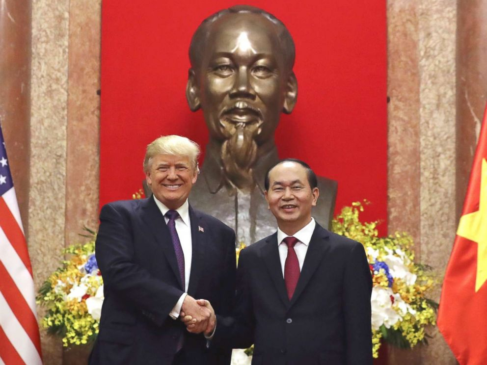 PHOTO: President Donald Trump, left, and Vietnamese President Tran Dai Quang shake hands at the Presidential Palace, Nov. 12, 2017, in Hanoi, Vietnam.