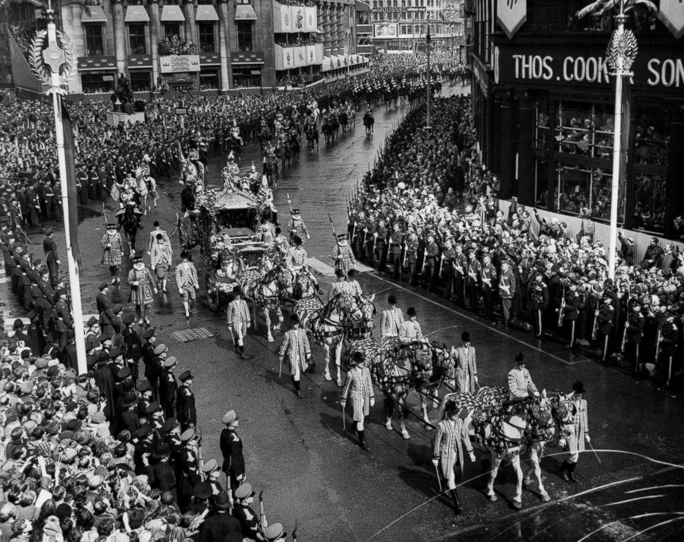 PHOTO: Crowds line Pall Mall as Queen Elizabeth II and her pageant pass on the way to her coronation ceremony, June 02, 1953.