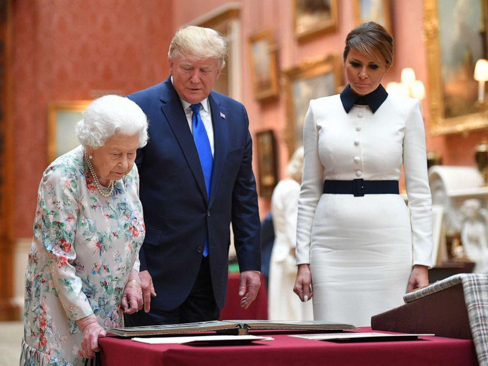 PHOTO: Queen Elizabeth views a display of US items of the Royal collection with President Donald Trump and US First Lady Melania Trump at Buckingham palace in London, June 3, 2019.