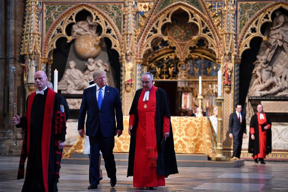 PHOTO: President Donald Trump is shown around Westminster Abbey by Dean of Westminster John Hall (r), June 3, 2019, in London.