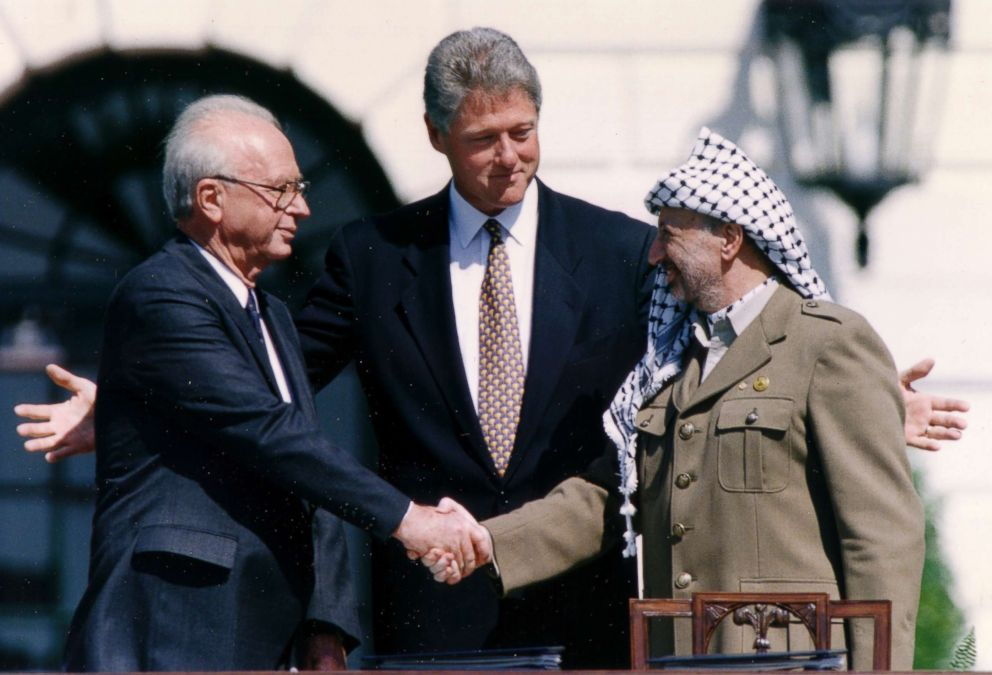 PHOTO: PLO Chairman Yasser Arafat (R) shake hands with Israeli Prime Minister Yitzhak Rabin (L), as President Bill Clinton stands between them, after the signing of the Israeli-PLO peace accord, at the White House in Washington, D.C., Sept. 13, 1993.