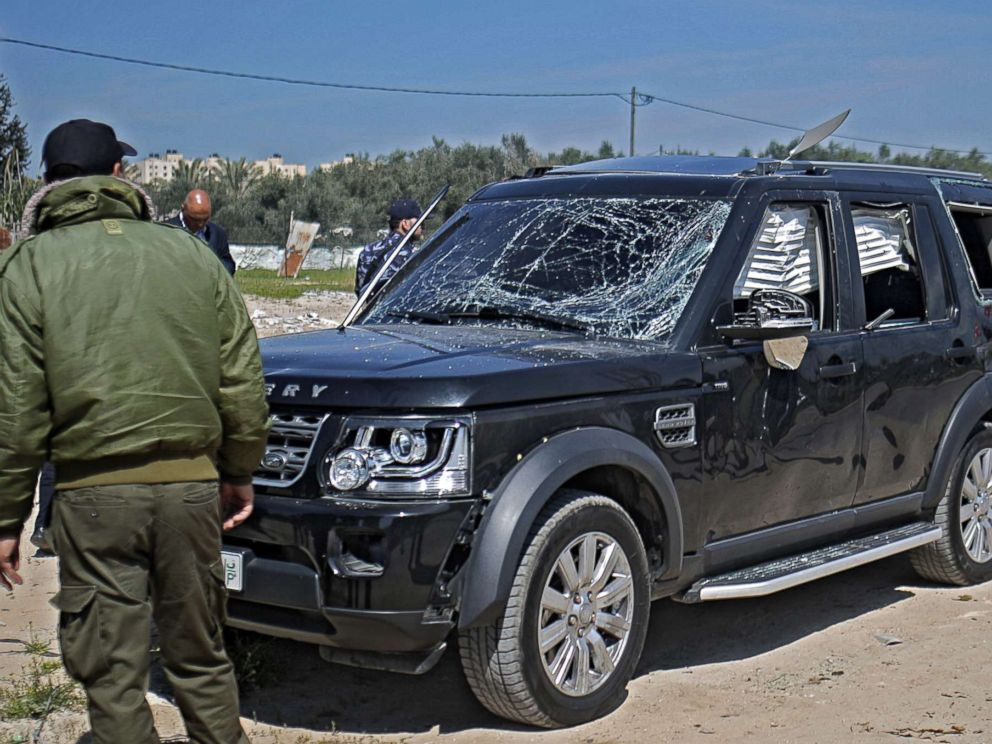 PHOTO: Hamas security officials inspect one of the cars of Palestinian Prime Minister Ramil Hamdallahs convoy that was targeted in an attack after his arrival in Beit Hanun town, the northern Gaza Strip, March 13, 2018.