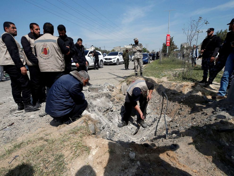 PHOTO: Palestinians inspect the site of an explosion that targeted a convoy that was carrying Palestinian Prime Minister Rami Hamdallah, in the northern Gaza Strip March 13, 2018.
