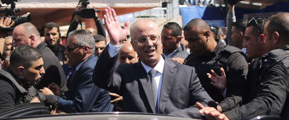 PHOTO: Palestinian Prime Minister Rami Hamdallah waves upon his arrival in Gaza City on March 13, 2018.