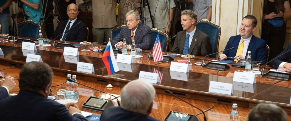 PHOTO: From left: a member of the Senate of the legislative Assembly of the state of Texas Peter Hettler, Texas Sen. Don Huffines, Sen. Rand Paul and his communications director Sergio Gor attend a meeting with Russian lawmakers in Moscow, Aug. 6, 2018.