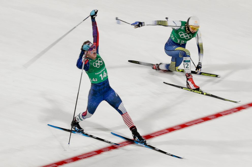 PHOTO: American Jessica Diggins celebrates after crossing the finish line and winning the gold medal past in the womens team sprint freestyle cross-country skiing final, Feb. 21, 2018. Stina Nilsson, of Sweden is in the background.