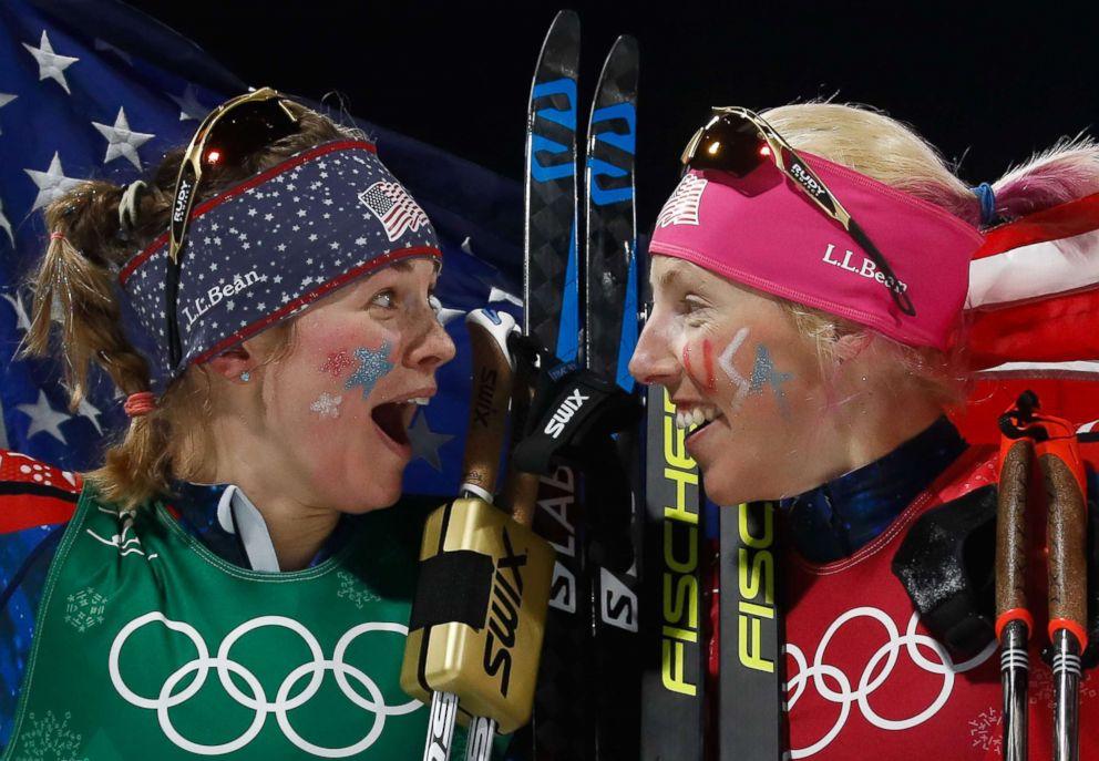 PHOTO: Americans Jessica Diggins, left Kikkan Randall celebrate winning gold in the womens cross country team sprint free final, Feb. 21, 2018.
