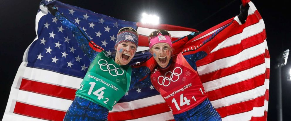 PHOTO: Americans Jessica Diggins, left and Kikkan Randall celebrate winning the gold medal in the womens cross country team sprint free final, Feb. 21, 2018.