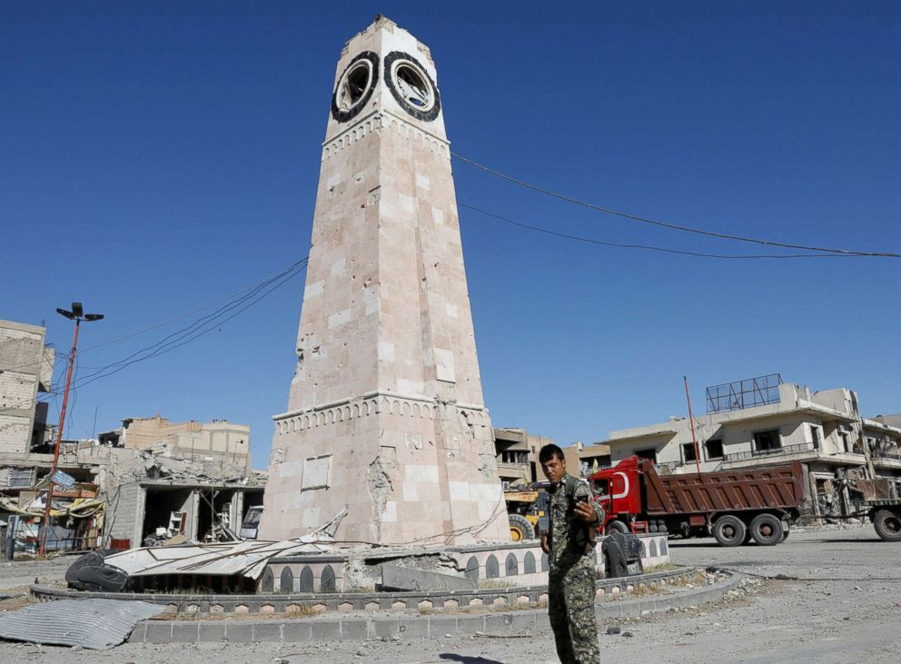 PHOTO: A fighter of Syrian Democratic Forces takes a selfie at a clock tower in Raqqa, Syria Oct. 18, 2017.