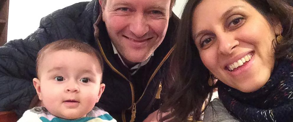 PHOTO: An undated handout image shows Nazanin Zaghari-Ratcliffe (R) posing for a photograph with her husband Richard and daughter Gabriella (L).