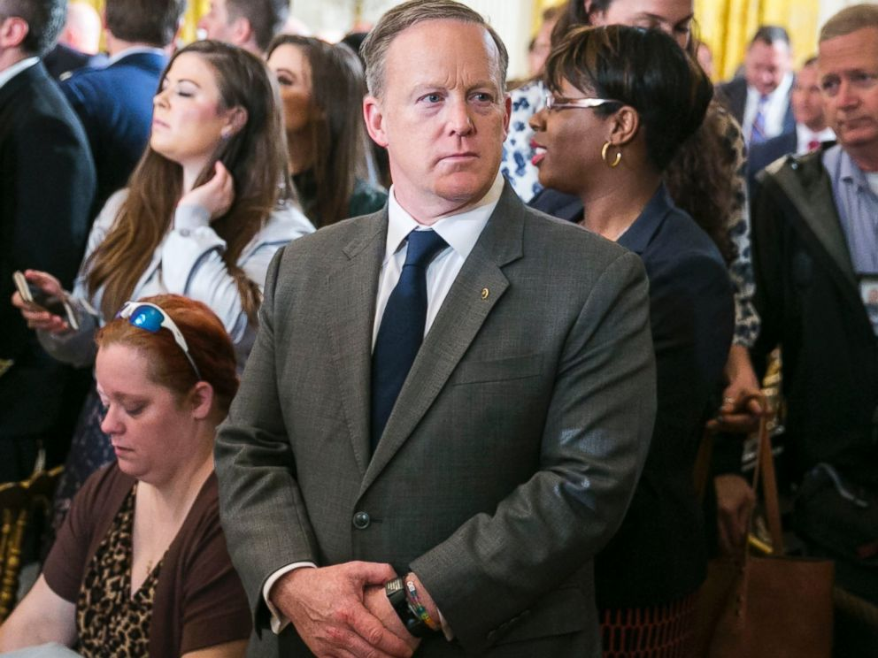 PHOTO: Sean Spicer, White House press secretary, stands at a gathering where President Trump spoke to participants in an annual Wounded Warrior Project Soldier Ride in the East Room at the White House in Washington, April 6, 2017.