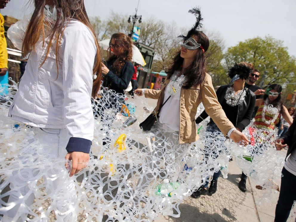 PHOTO: Demonstrators march together in plastic six pack rings during a demonstration to mark Earth Day in Manhattan, April 22, 2014, in this file photo in New York City.