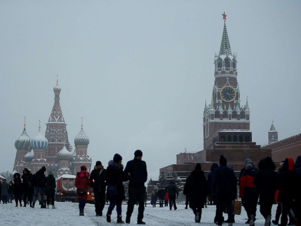 PHOTO: People walk during snowfall in Red Square in Moscow, Dec. 24, 2018.