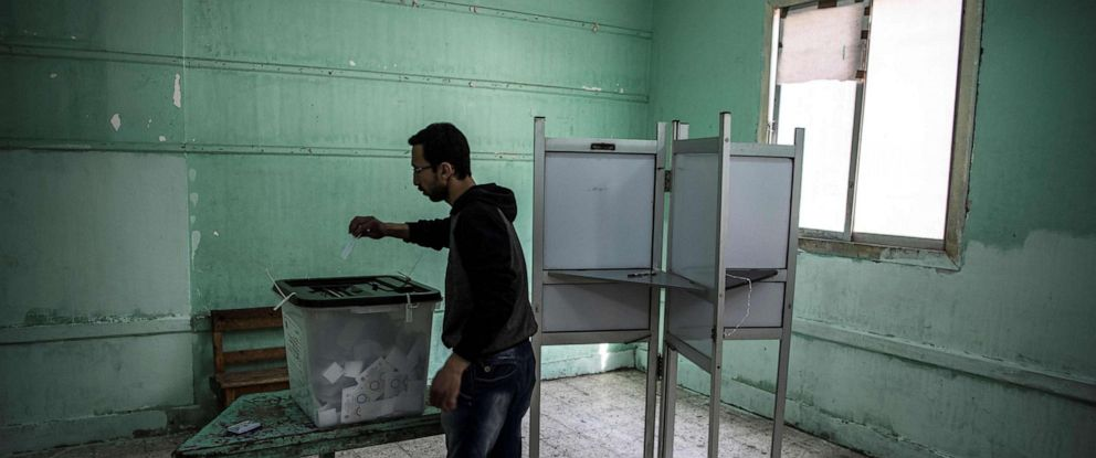 PHOTO: TAn Egyptian man casts his vote in a polling station during the third day of a referendum on constitutional amendments in Cairo, April 22, 2019.