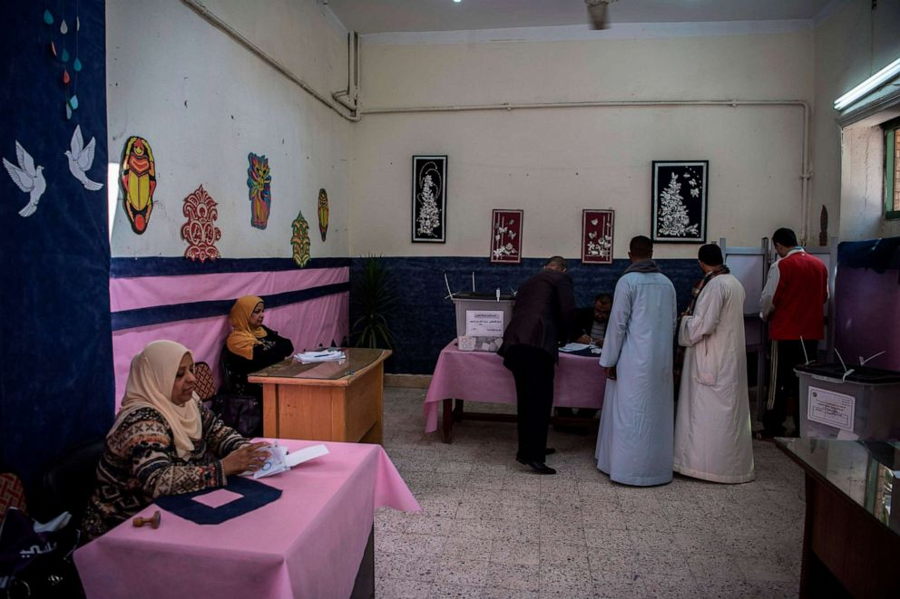 PHOTO: Egyptian voters cast their votes at a polling station during the third day of a referendum on constitutional amendments in Cairo, April 22, 2019.