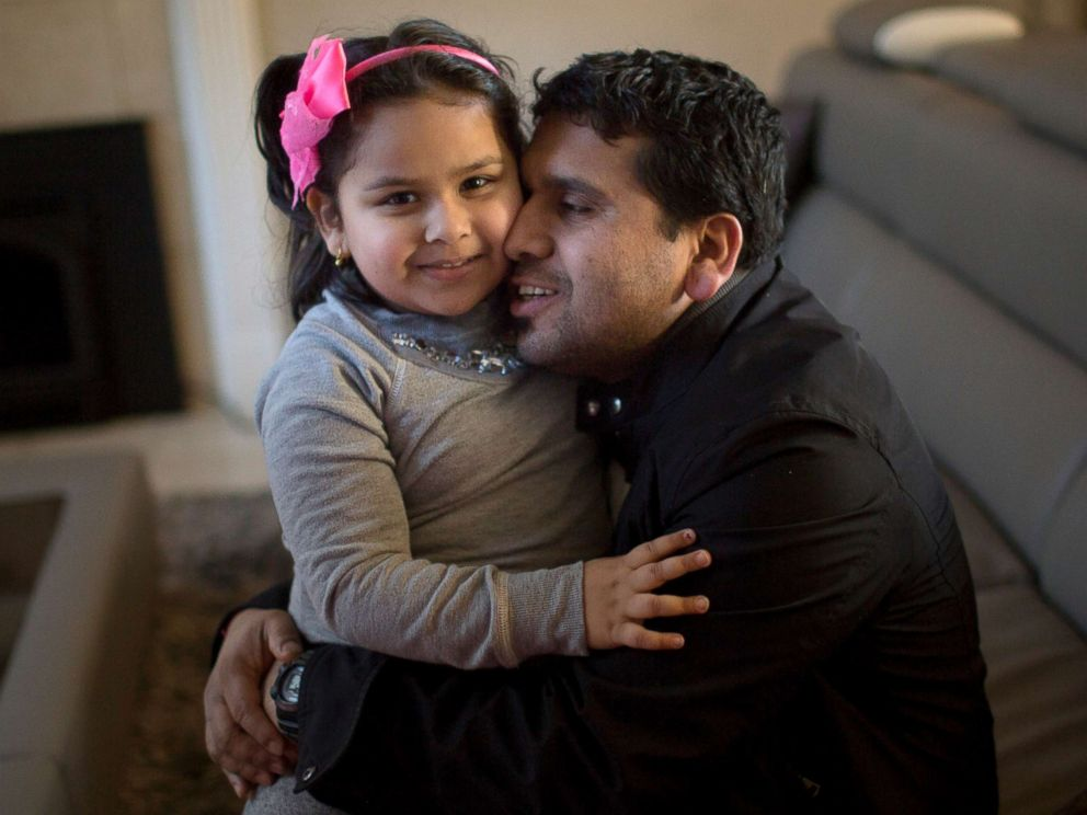 PHOTO: Somu Timsina hugs his daughter in Colchester, Vermont, Feb. 2, 2016. He moved to the area with the assistance of the Vermont Refugee Resettlement Program, which has resettled over 1700 other Nepali-Bhutanese refugees in the state since 2008.