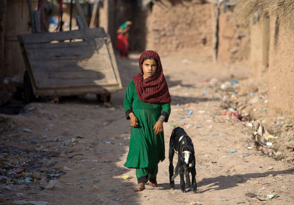 PHOTO: An girl from neighboring Afghanistan, who fled her village with her family due to war and famine, walks in a refugee camp in a suburb of Islamabad, Pakistan, June 19, 2018.