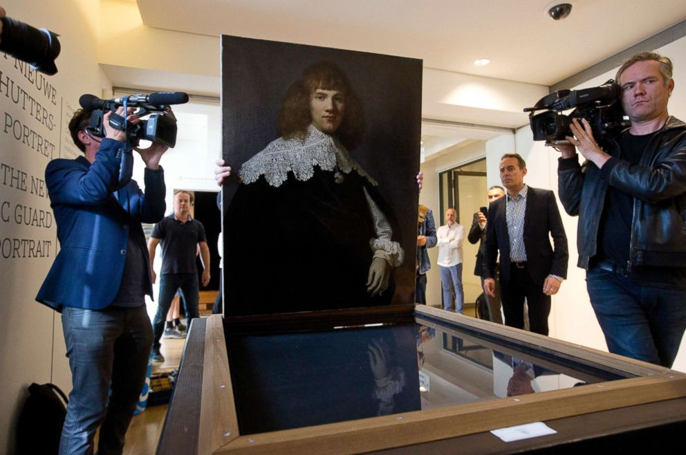 PHOTO: A painting attributed to famous Dutch Master Rembrandt is prepared for display at the Hermitage museum in Amsterdam, May 16, 2018. The unsigned painting which will be sold by gallery owner Jan Six, after being exhibited.