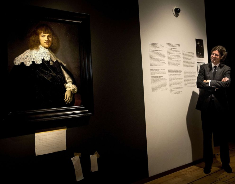 PHOTO: Amsterdam art dealer and historian Jan Six stands beside Portrait of a Young Gentleman by Rembrandt van Rijn in The Hermitage Museum, Amsterdam, May 16, 2018.