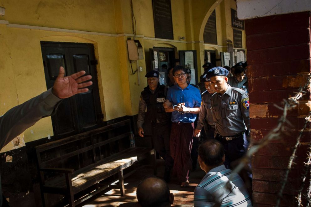 PHOTO: Reuters journalist Wa Lone (C) is escorted by police after a court appearance in Yangon, Jan. 10, 2018.