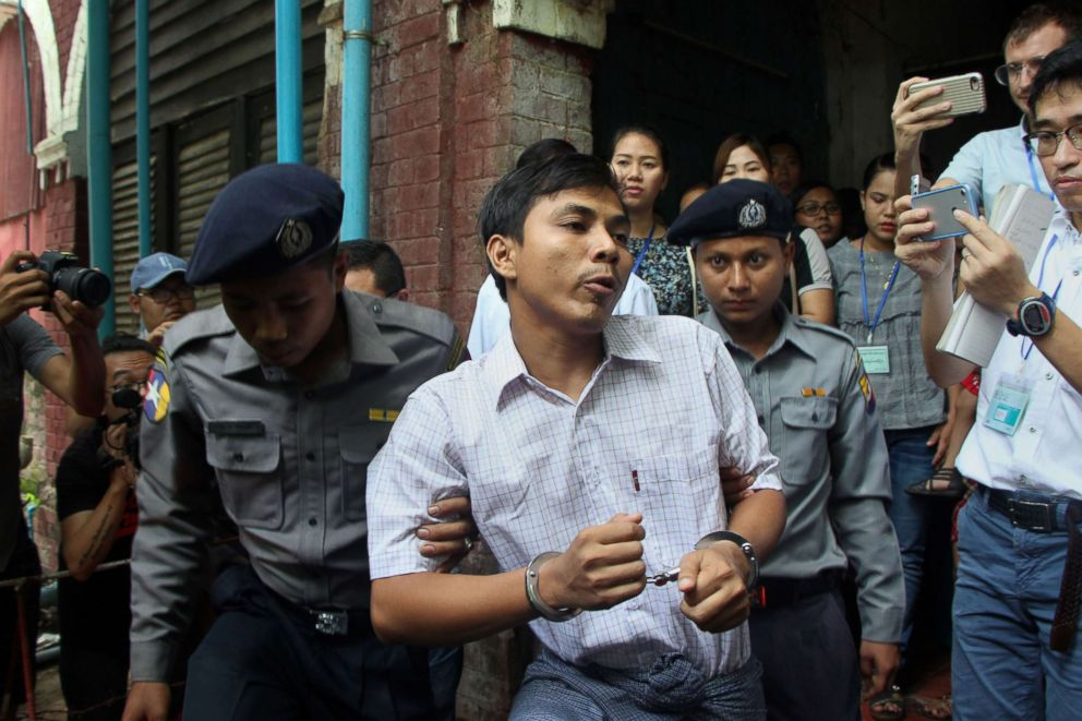 PHOTO: Detained Myanmar journalist Kyaw Soe Oo (C) is escorted by police to a court for his ongoing trial in Yangon, May 2, 2018.