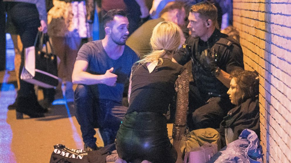 People gather near the Manchester Arena after reports of an explosion on May 22, 2017 in Manchester, England.