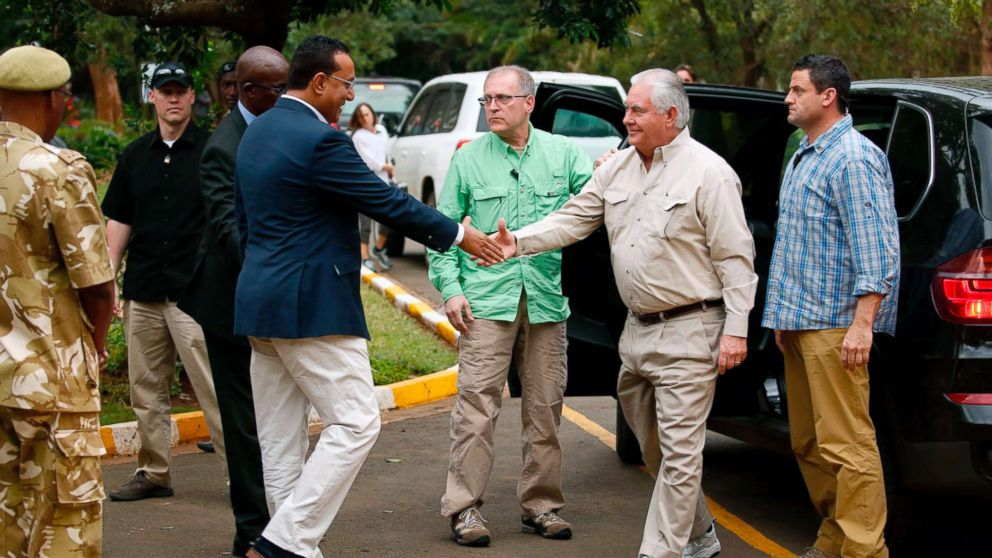 Kenya's Cabinet Secretary for Tourism Najib Balala (2-L) shakes hands with US Secretary of State Rex Tillerson (2-R) prior to a tour of the Kenya Wildlife Service in Nairobi, on March 11, 2018.