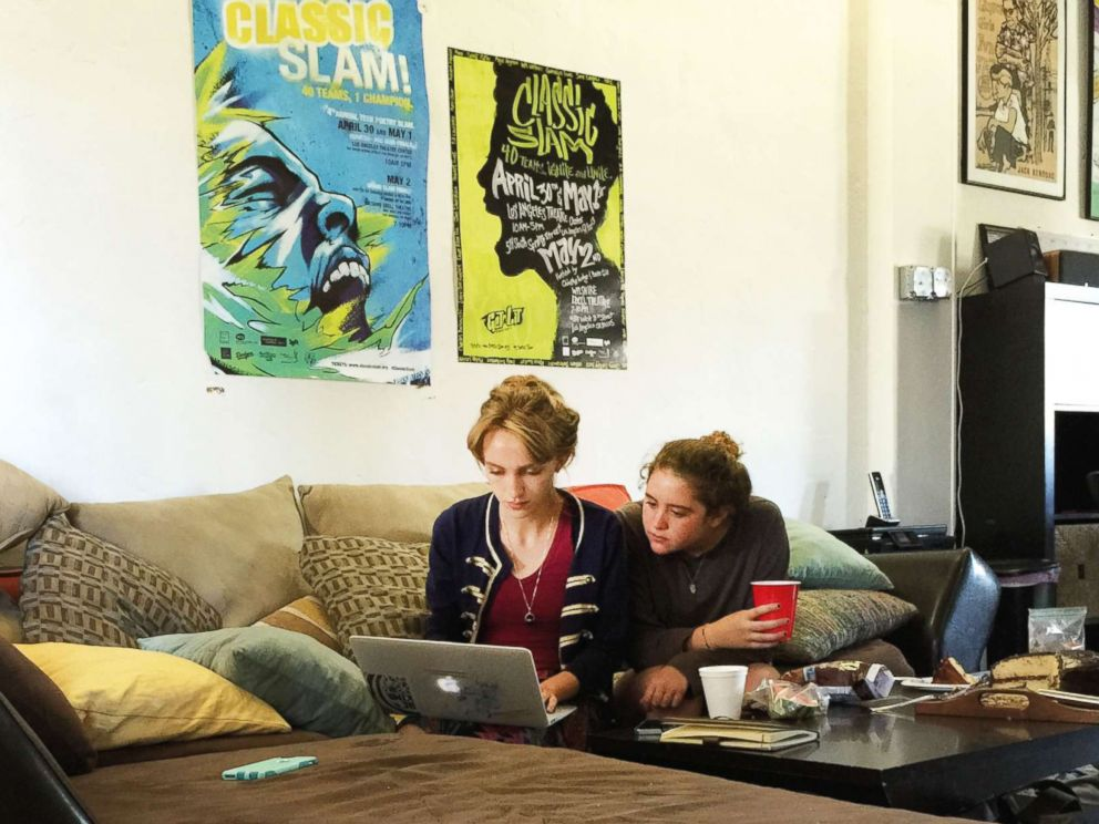 PHOTO: Rhiannon McGavin 17, and Miriam Sachs, members of Get Lit, polish a word poem during a Saturday working session. The time Get Lit poets were finalists in a competition, they third in the world.
