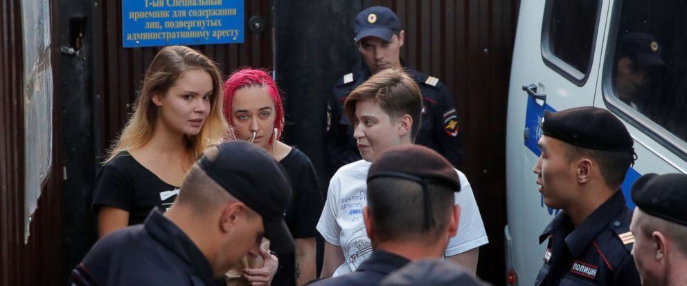 PHOTO: Members of Pussy Riot Veronika Nikulshina, Olga Kurachyova and Olga Pakhtusova walk out of a detention center after after spending 15 days in jail in Moscow, Russia, July 30, 2018.