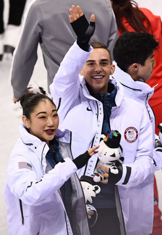 PHOTO: USAs Mirai Nagasu (L) and USAs Adam Rippon celebrate during the venue ceremony after winning bronze in the figure skating team event during the Pyeongchang 2018 Winter Olympic Games at the Gangneung Ice Arena in Gangneung, Feb. 12, 2018.