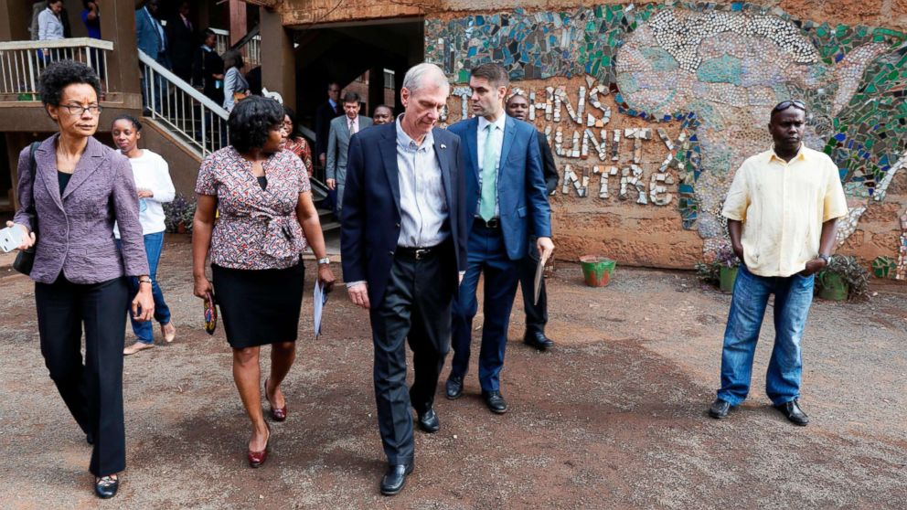 U.S. Ambassador to Kenya Robert Godec (C) visits a President's Emergency Plan for AIDS Relief (PEPFAR) project for girls' empowerment in Nairobi, March 10, 2018.