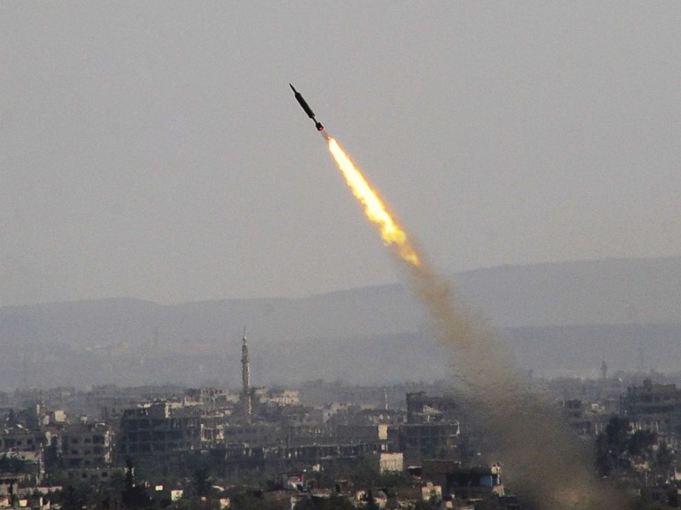 PHOTO: A rocket is seen launched by the Syrian army in Eastern Ghouta countryside of Damascus, Syria, on April 7, 2018.