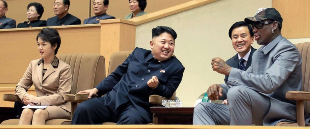 PHOTO: Former basketball star Dennis Rodman, right, and North Korean leader Kim Jong Un, 2nd from left, watch a basketball game between American and North Korean players at the Pyongyang Indoor Stadium on Jan. 8, 2014.