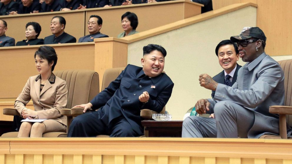 Former U.S. basketball star Dennis Rodman, right, and North Korean leader Kim Jong Un, 2nd from left, watch an exhibition basketball game between American and North Korean players at the Pyongyang Indoor Stadium on Jan. 8, 2014, with Kim's wife Ri Sol Ju sitting next to Kim.