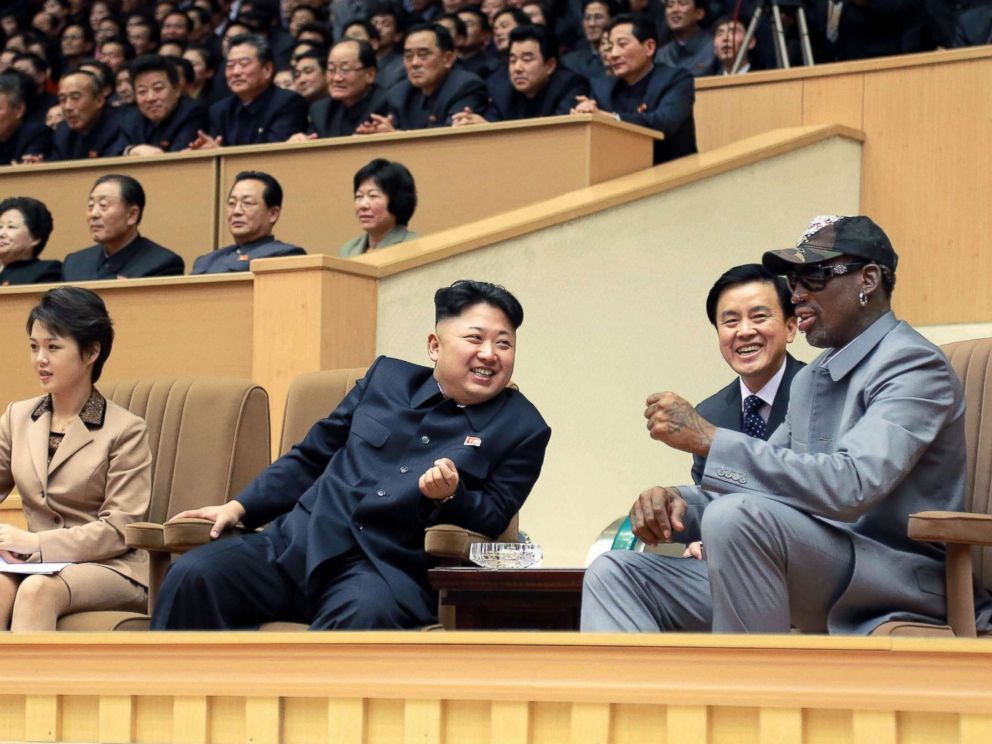 Dennis Rodman right and North Korean leader Kim Jong Un 2nd from left watch a basketball game between American and North Korean players at the Pyongyang Indoor Stadium on Jan. 8 2014