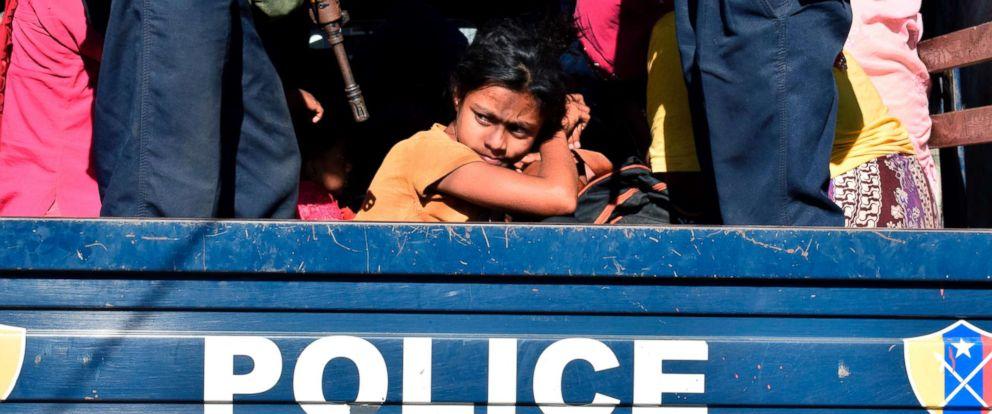 PHOTO: Myanmar police escort Rohingya Muslims back to their camp in Sittwe, Rakhine state, on Nov. 30, 2018.