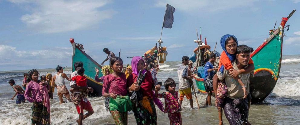 PHOTO: Rohingya Muslims walk to the shore after arriving on a boat from Myanmar to Bangladesh, Sept. 14, 2017. Nearly three weeks into a mass exodus of Rohingya fleeing violence in Myanmar.