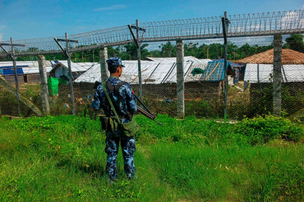 PHOTO: A Myanmar border guard policeman patrols along the border between Myanmar and Bangladesh in Maungdaw, Rakhine state, on June 29, 2018.