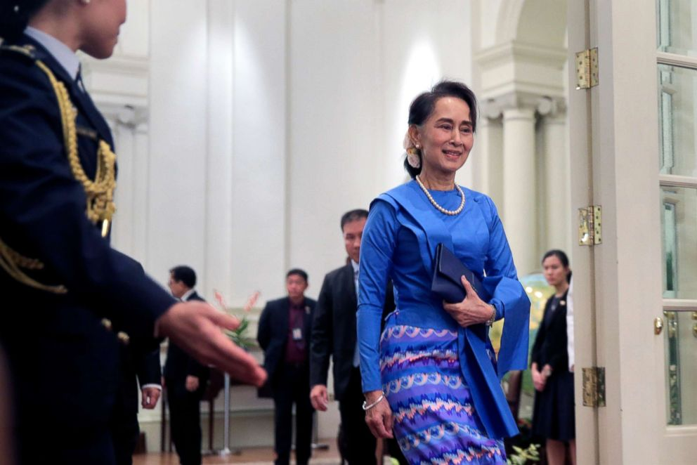 PHOTO: Myanmar State Counsellor Aung San Suu Kyi is ushered by an aide-de-camp at the Istana Presidential Palace in Singapore, Aug. 21, 2018.