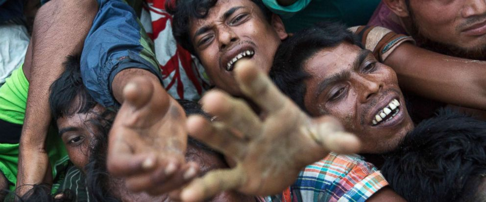 PHOTO: Rohingya Muslims stretch out their arms to reach food being distributed near Balukhali refugee camp in Coxs Bazar, Bangladesh, Sept. 20, 2017.