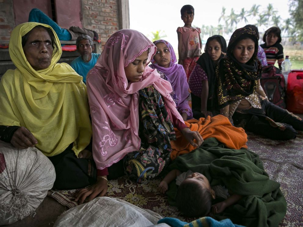 PHOTO: Recently arrived Rohingya refugees rest after crossing into Bangladesh, Nov. 24, 2017 in Coxs Bazar, Bangladesh.