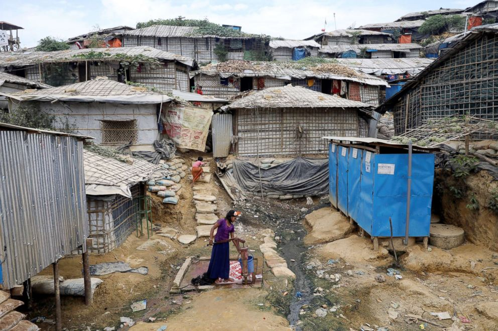 PHOTO: A Rohingya refugee girl collects water from a tube-well at the Balikhali camp in Coxs Bazar, Bangladesh, Nov. 14, 2018.