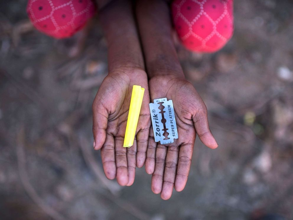 PHOTO: Rohingya migrant girl Halima Khatun (6), who arrived in Bangladesh in October, holds a whistle and a razor blade that she uses as toys at the Shamlapur refugee camp in Coxs Bazar, Dec. 1, 2017.