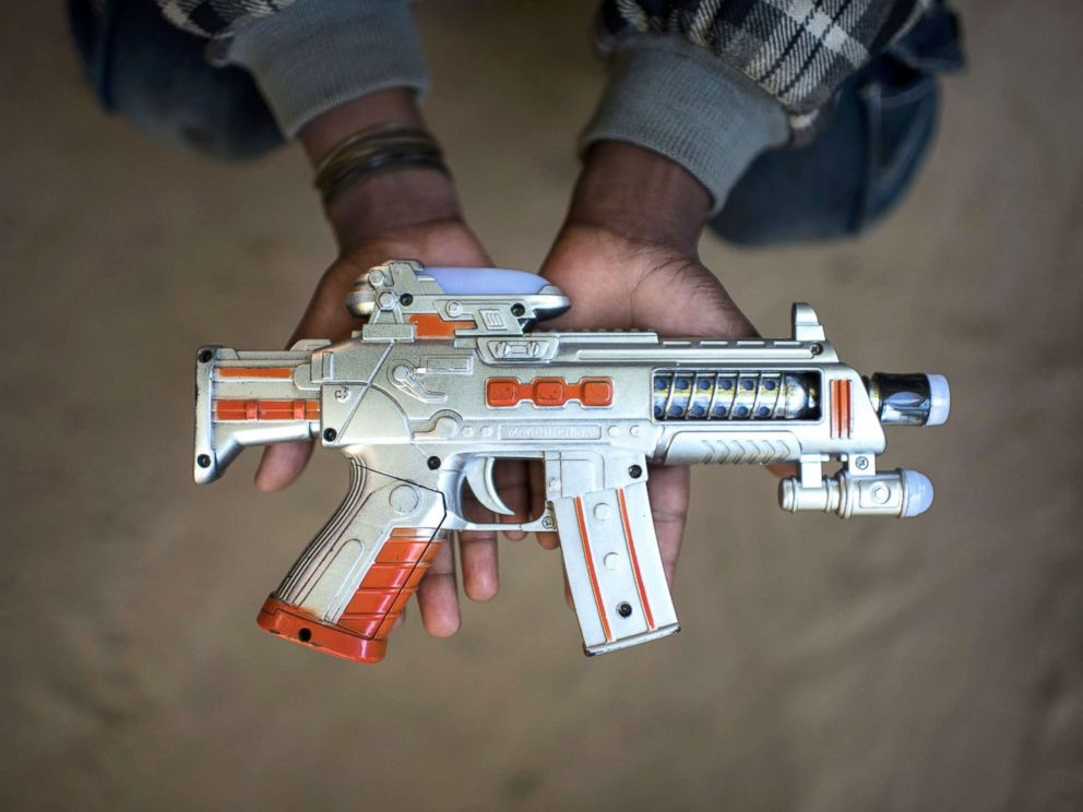 PHOTO: Rohingya migrant boy Saiful Islam (9), who fled Myanmar three years ago, holds a toy gun at the Shamlapur refugee camp in Coxs Bazar, Dec. 1, 2017.