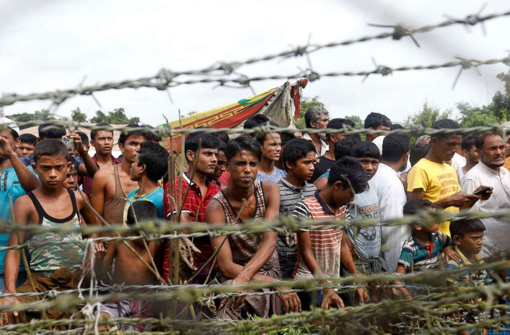 PHOTO: Rohingya refugees gather near a fence at the no mans land zone at the Bangladesh-Myanmar border in Maungdaw district, Rakhine State, western Myanmar, Aug. 24, 2018.
