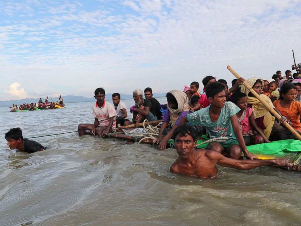 PHOTO: Rohingya refugees cross the Naf River with an improvised raft to reach to Bangladesh in Teknaf, Bangladesh, Nov. 12, 2017.