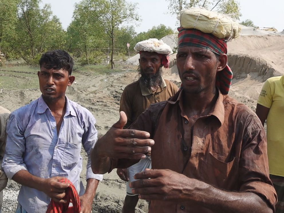 PHOTO: Workers describe the housing the Bangladesh government is building for thousands of Rohingya refugees.