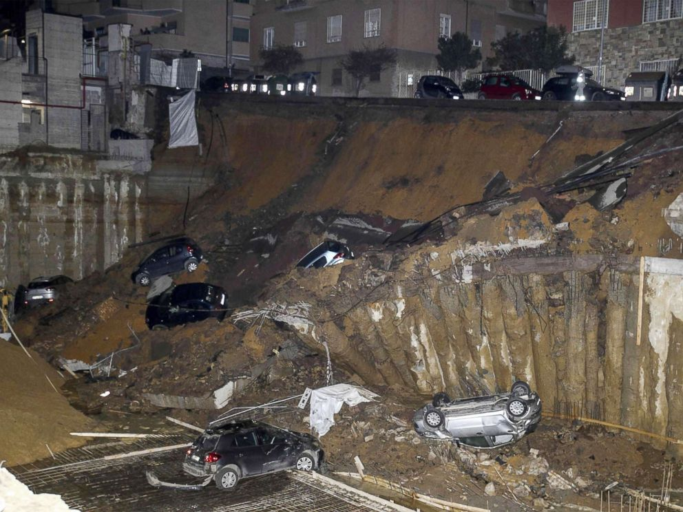 PHOTO: A view is captured of a large sinkhole that opened in a street of a residential area in Rome, on Feb. 14, 2018.