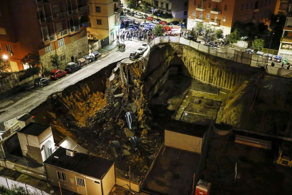 PHOTO: The view of a large sinkhole that opened in a street of a residential area in Rome on Feb. 14, 2018 is captured.