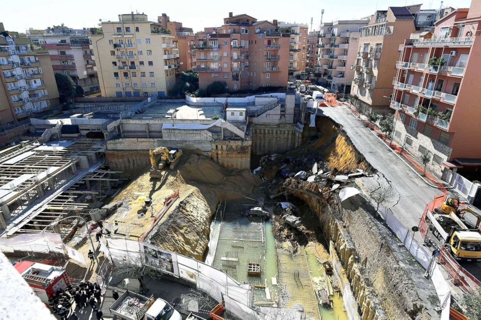 PHOTO: The picture taken on Feb. 15, 2018, in the street of Balduinas district in Rome shows a huge sinkhole that opened up the day before swallowing six cars.